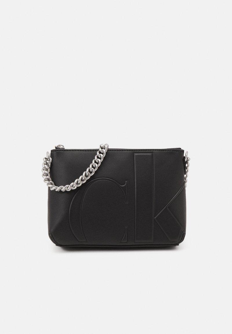 Calvin Klein Jeans - CAMERA POUCH - Taška spříčným popruhem - black