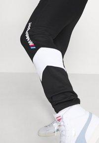 Puma - BMW TRACK PANTS - Tracksuit bottoms - black - 5