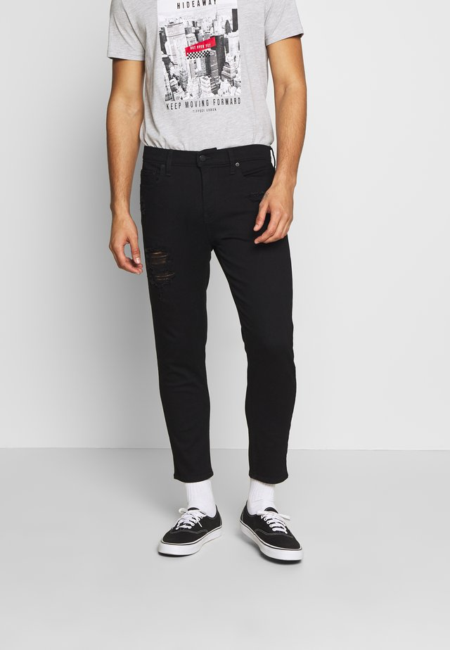 TAPER CROP REPAIR - Zúžené džíny - black