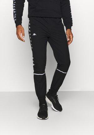 JARUS - Pantaloni sportivi - caviar