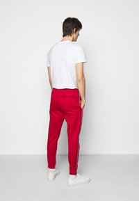 Polo Ralph Lauren - LUX TRACK - Pantalones deportivos - red - 2
