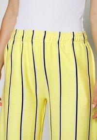 Obey Clothing - RONNY PANTS - Tracksuit bottoms - lemon multi - 4