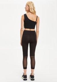 DeFacto Fit - Leggings - Trousers - black - 2