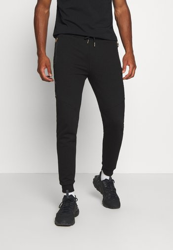 SHERWIN - Pantaloni sportivi - black