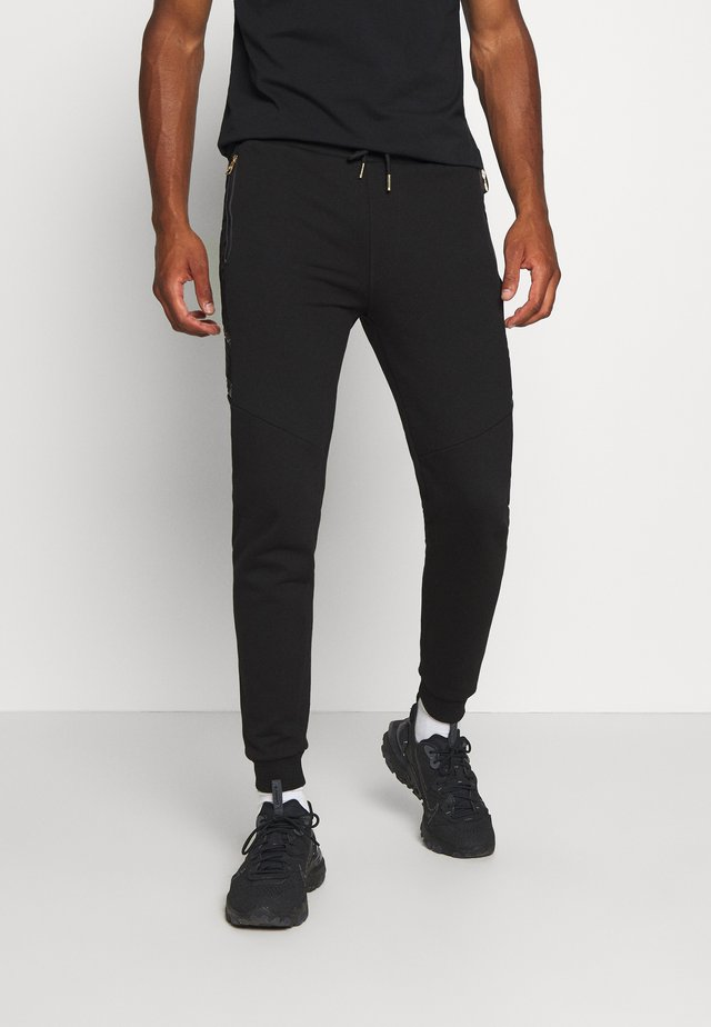 SHERWIN - Pantalones deportivos - black
