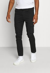 RETHINK Status - PANTS - Cargo trousers - black - 0