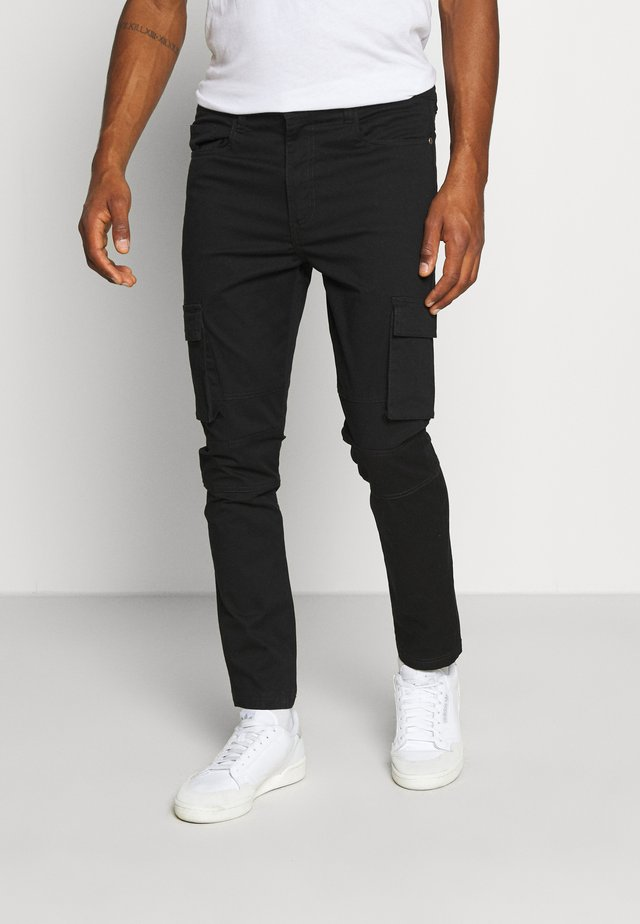 PANTS - Reisitaskuhousut - black