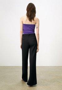 Uterqüe - FLOWING  - Trousers - black - 4