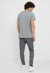 Nike Sportswear - OPTIC - Tracksuit bottoms - dark grey/heather - 2