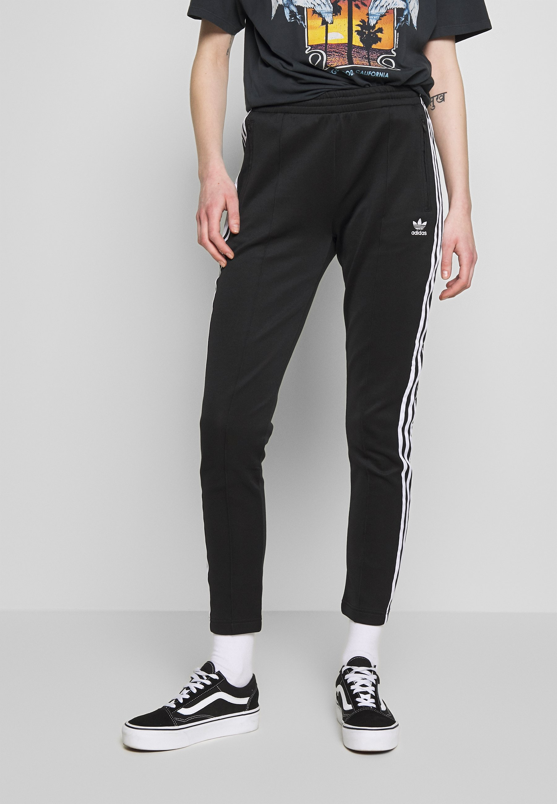 Converger Esplendor exégesis  adidas Originals SUPERSTAR SUPER GIRL ADICOLOR TRACK PANTS - Pantalon de  survêtement - black/white/noir - ZALANDO.FR
