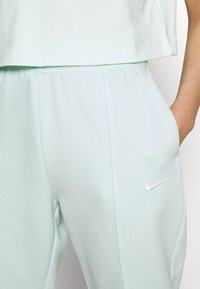 Nike Sportswear - PANT TREND - Tracksuit bottoms - barely green/white - 4