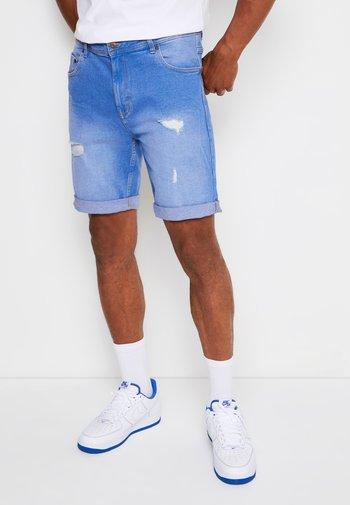 ORANGE DESTROY - Denim shorts - royal blue