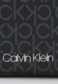 Calvin Klein - CAMERA BAG - Across body bag - black - 5