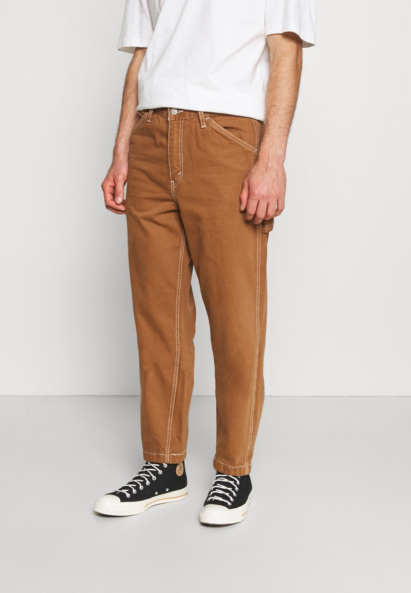 Levi's® - TAPERED CARPENTER - Relaxed fit jeans - toffee
