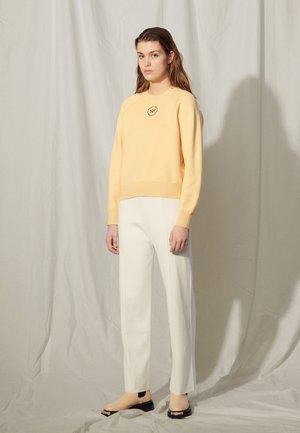 Sweatshirt - jaune pâle
