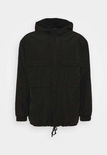 OVERSIZED ANORAK - Lehká bunda - black