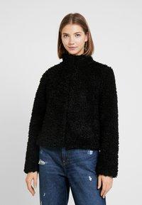Vero Moda - VMVIRIGINIATEDDY HIGH NECK - Winter jacket - black - 0
