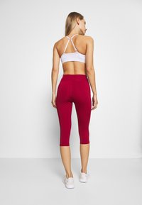 Even&Odd active - 3/4 sports trousers - dark red - 2