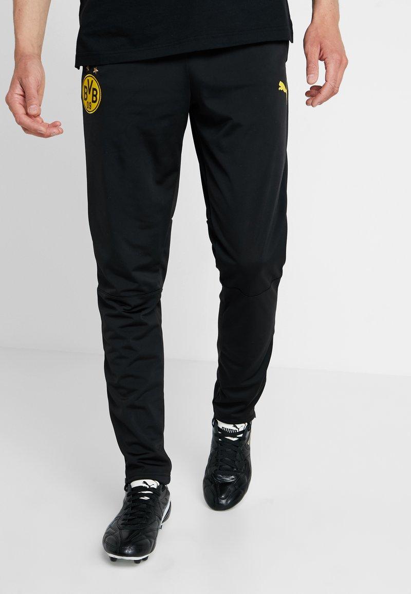 Puma - BVB BORUSSIA DORTMUND TRAINING PANTS WITH ZIP POCKETS - Tracksuit bottoms - black/cyber yellow