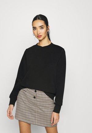 NMLUPA - Sweatshirt - black