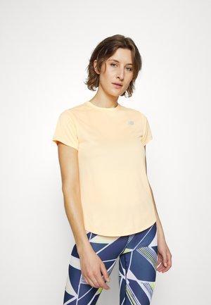 ACCELERATE SHORT SLEEVE - Basic T-shirt - light mango