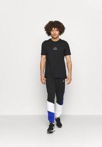 adidas Performance - COLORBLOCK SEASONAL - Pantaloni sportivi - black/bold blue - 1