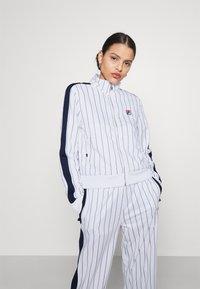 Fila - HALA TRACK JACKET - Summer jacket - blanc de blanc/black iris - 0
