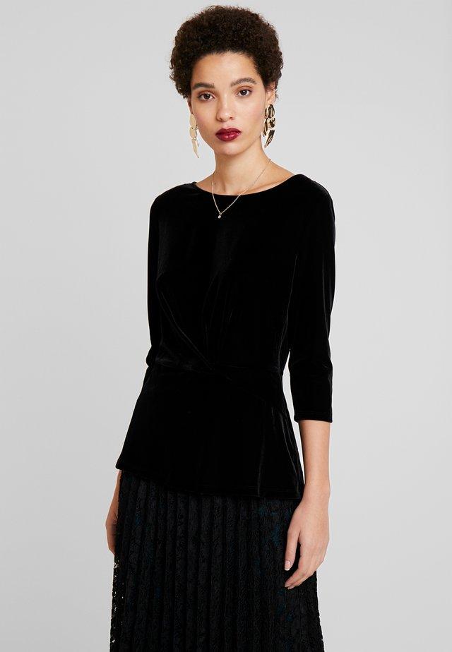 WINTER STRETCH - Maglietta a manica lunga - black