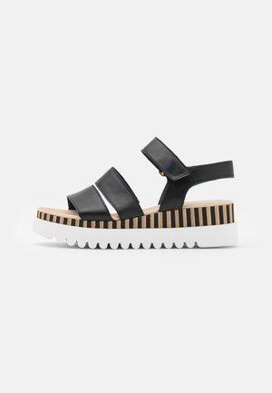 Sandalen met plateauzool - schwarz/natur