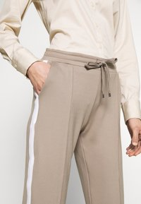 Rich & Royal - PANTS - Tracksuit bottoms - taupe - 4