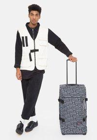 Eastpak - TRANVERZ M - Wheeled suitcase - bold branded - 0
