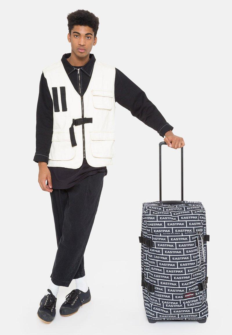 Eastpak - TRANVERZ M - Wheeled suitcase - bold branded