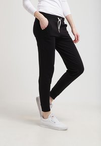 Zalando Essentials - Tracksuit bottoms - black - 3
