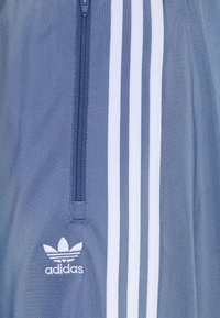 adidas Originals - FIREBIRD UNISEX - Tracksuit bottoms - crew blue - 5