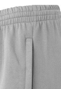 Hummel - HMLGO - Tracksuit bottoms - grey melange - 2