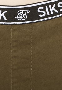 SIKSILK - DISTRESSED - Tracksuit bottoms - khaki - 5