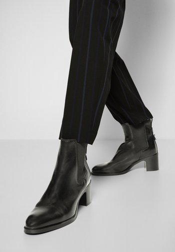 ANNYLEE - Classic ankle boots - black