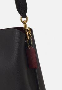 Coach - POLISHED PEBBLE WILLOW SHOULDER BAG - Handbag - black - 5