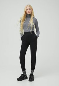 PULL&BEAR - Tracksuit bottoms - black - 1