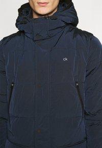 Calvin Klein - CRINKLE LONG LENGTH JACKET - Winter coat - blue - 6