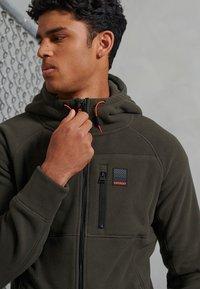 Superdry - POLAR FLEECE - Zip-up hoodie - dark grey green - 1