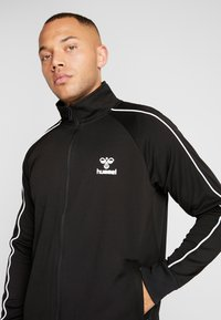 Hummel - ARNE ZIP JACKET - Training jacket - black - 4