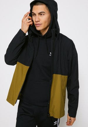 OUTERIOR RAIN.RDY - Waterproof jacket - black/wild moss