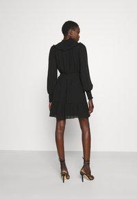 MICHAEL Michael Kors - SWISS DOT SMOCKED DRESS - Denní šaty - black - 2