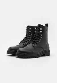 Versace Jeans Couture - Lace-up ankle boots - nero - 1