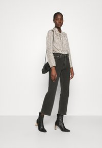 ARKET - Relaxed fit jeans - black dark - 1
