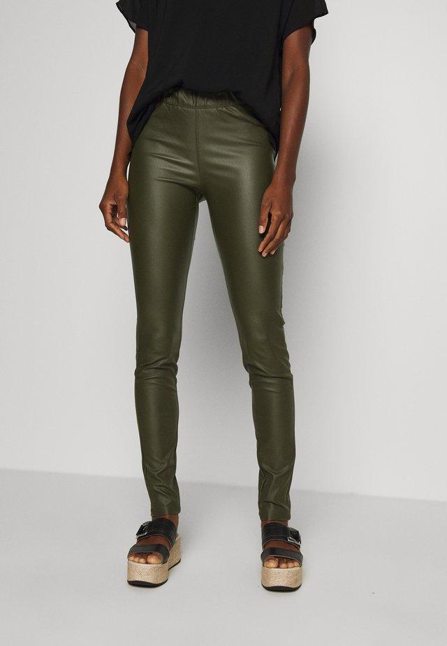 ADA COATED - Leggings - Trousers - grape leaf