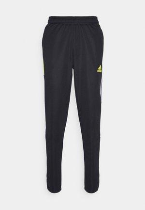 TIRO  - Spodnie treningowe - black/yellow
