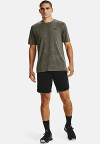 Under Armour - Sports shorts - black - 1