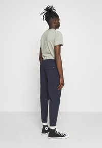 Hollister Co. - PULLON CROP TAPER PLAID - Trousers - navy